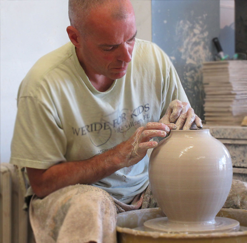 Marc Lemeuix hand throwing a cremation urn
