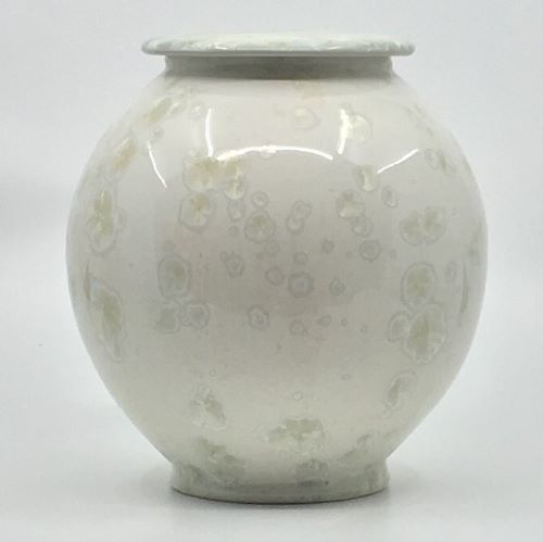 Large white urn with white crystals